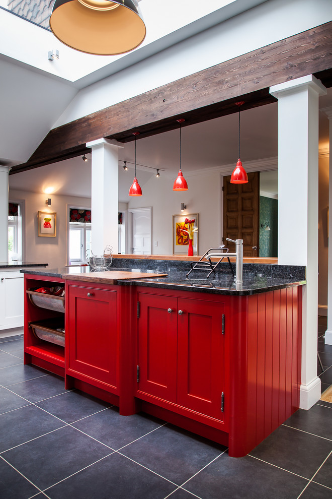 Inspiration for a large cottage ceramic tile enclosed kitchen remodel in Hertfordshire with an undermount sink, shaker cabinets, red cabinets, granite countertops, ceramic backsplash, stainless steel appliances and an island