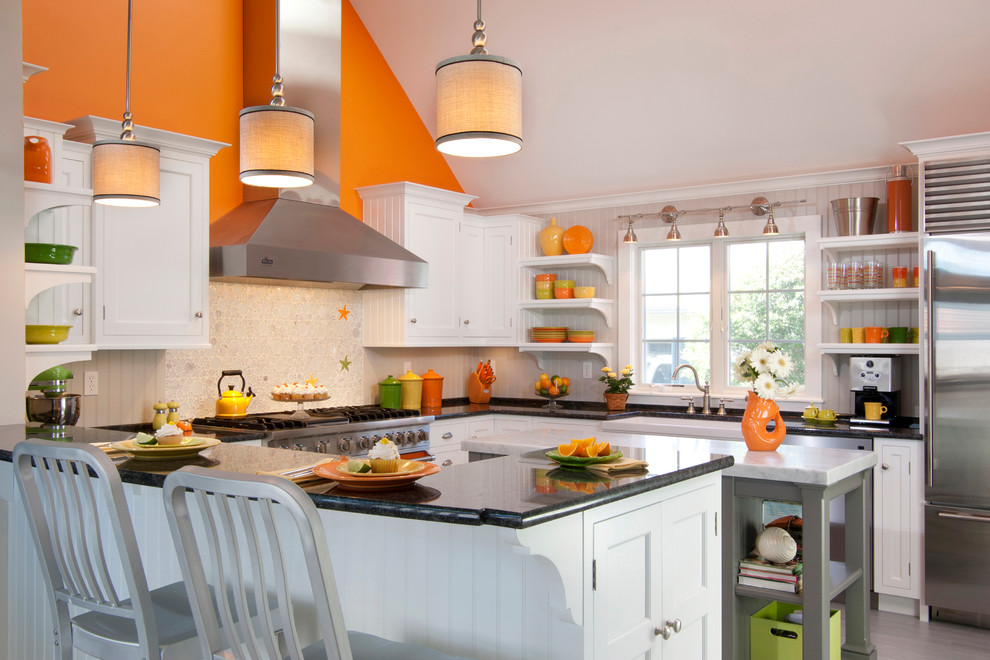 Example of a large country u-shaped ceramic tile and gray floor eat-in kitchen design in Other with a farmhouse sink, white cabinets, marble countertops, white backsplash, glass tile backsplash, colored appliances, an island and recessed-panel cabinets