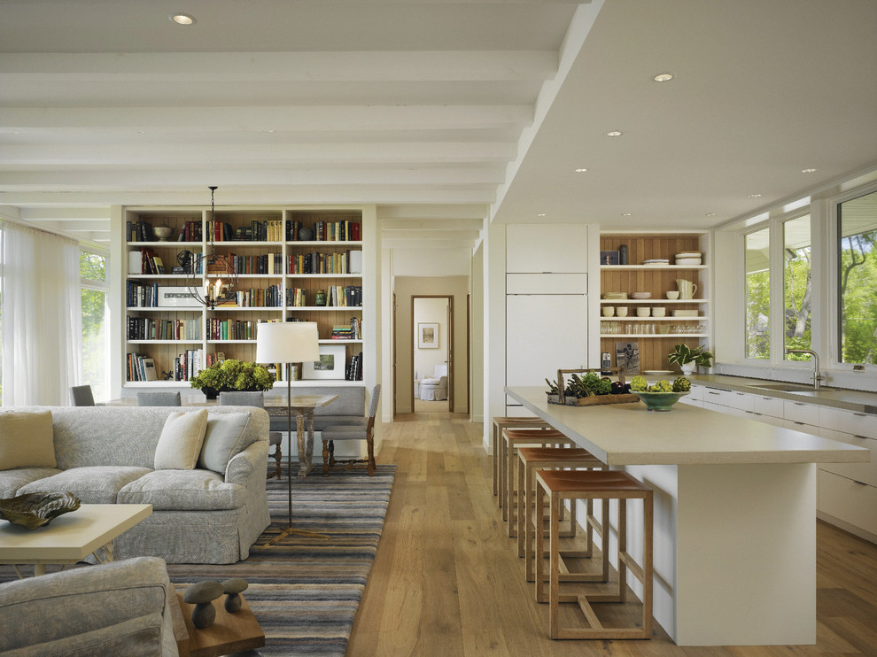 Large transitional l-shaped medium tone wood floor open concept kitchen photo in Other with an undermount sink, flat-panel cabinets, white cabinets, paneled appliances, an island and quartz countertops
