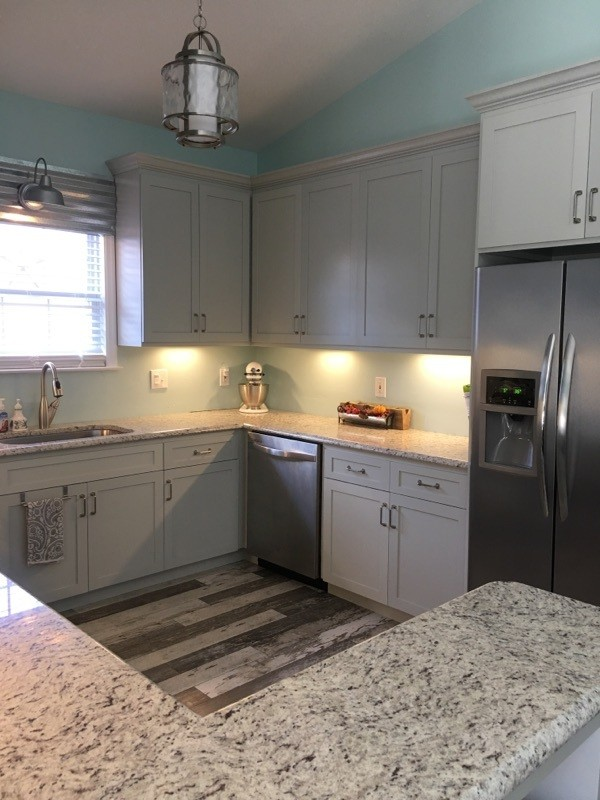 Eat-in kitchen - mid-sized eat-in kitchen idea in Jacksonville with shaker cabinets, gray cabinets and granite countertops