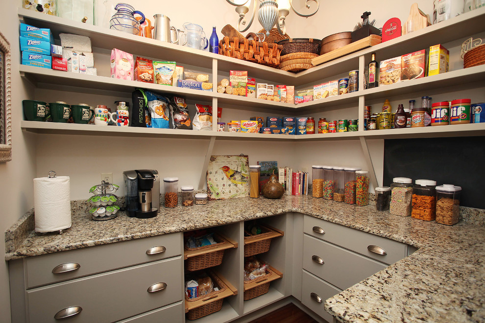 Example of a classic kitchen pantry design in Charlotte with open cabinets