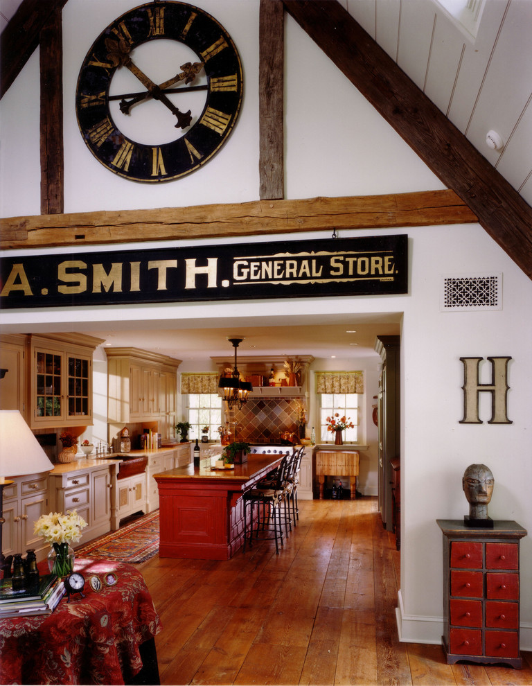 Eclectic kitchen photo in Philadelphia with recessed-panel cabinets, beige cabinets and brown backsplash