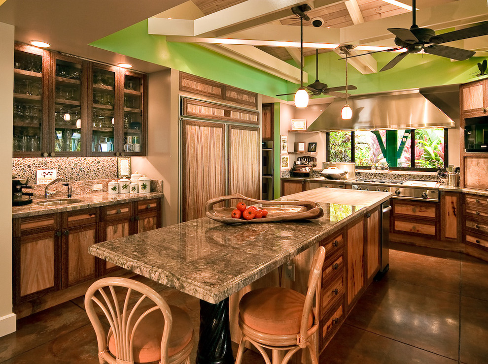 Inspiration for a tropical enclosed kitchen remodel in Hawaii with glass-front cabinets, medium tone wood cabinets and paneled appliances