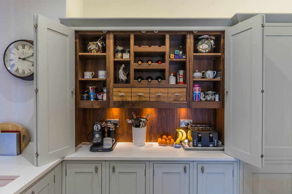 Example of a mid-sized classic eat-in kitchen design in Cheshire with an undermount sink, gray cabinets, white backsplash, raised-panel cabinets, marble countertops and an island