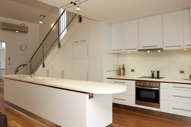 Inspiration For A Contemporary Kitchen Remodel In Adelaide With Flat Panel  Cabinets And White Cabinets