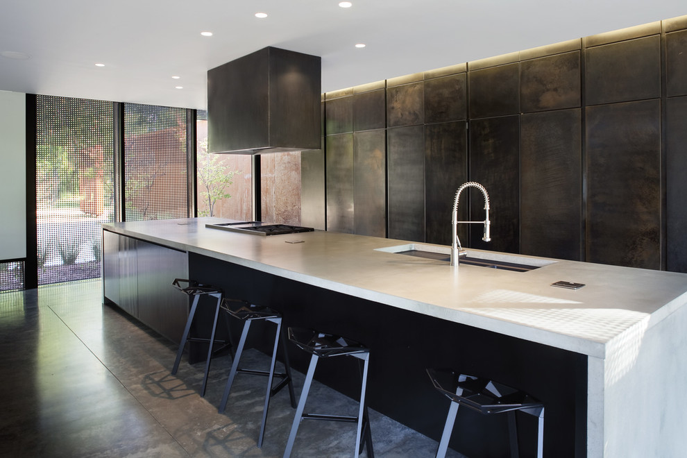 Example of a trendy galley kitchen design in Kansas City with flat-panel cabinets and gray cabinets