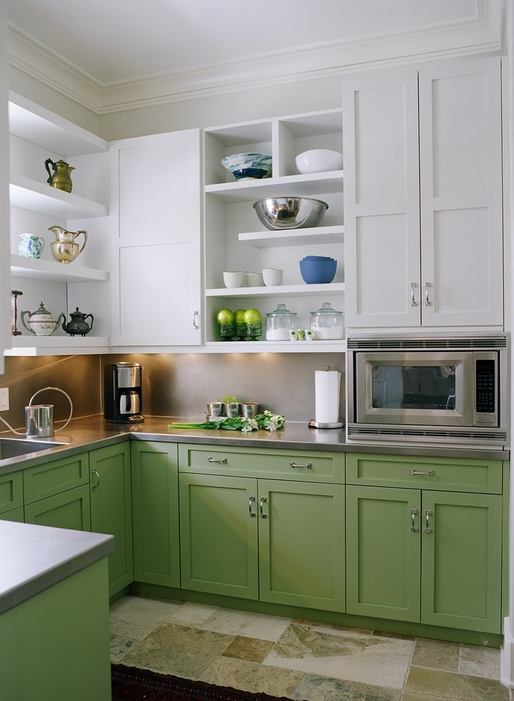 Example of a transitional u-shaped kitchen design in Nashville with an integrated sink, shaker cabinets, green cabinets, stainless steel countertops, metallic backsplash, stainless steel appliances and no island