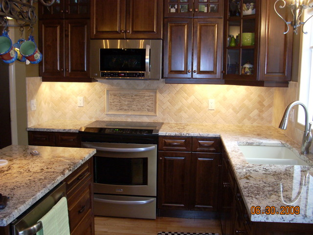 herringbone travertine backsplash