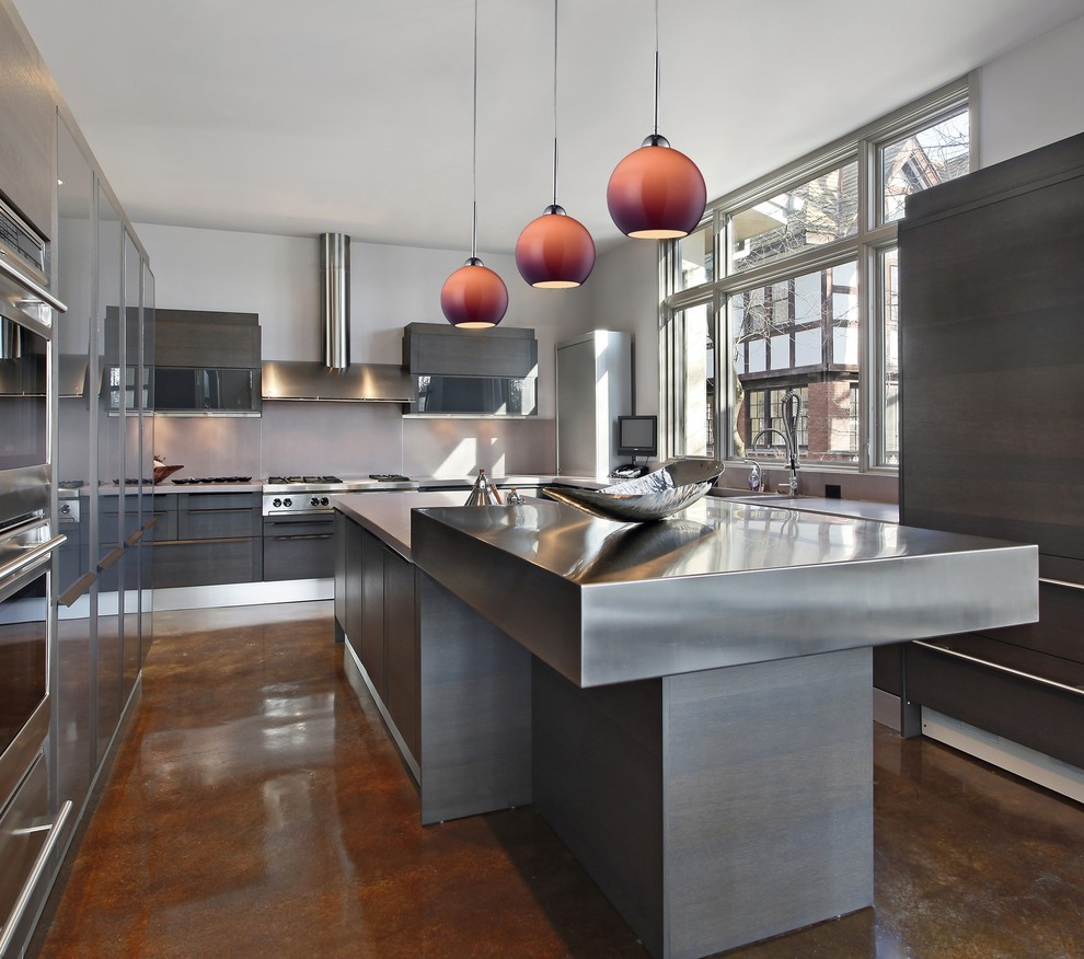 Eat-in kitchen - mid-sized modern u-shaped medium tone wood floor eat-in kitchen idea in New York with a drop-in sink, flat-panel cabinets, gray cabinets, stainless steel countertops, gray backsplash, cement tile backsplash, stainless steel appliances and an island