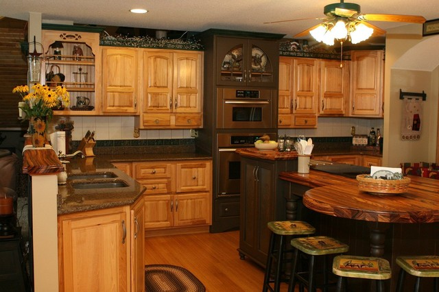 Hickory kitchen with unique island shape traditional for Kitchen designs for odd shaped rooms
