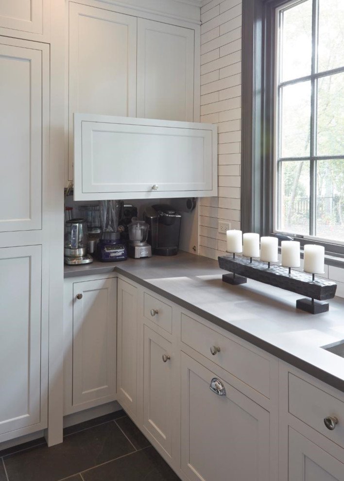Example of a huge farmhouse porcelain tile and brown floor kitchen pantry design in Chicago with a double-bowl sink, recessed-panel cabinets, white cabinets, marble countertops, white backsplash, ceramic backsplash and stainless steel appliances