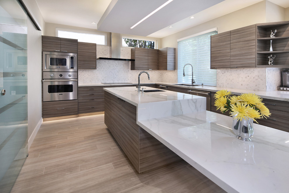 Inspiration for a modern porcelain tile eat-in kitchen remodel in Orange County with flat-panel cabinets, gray cabinets and an island