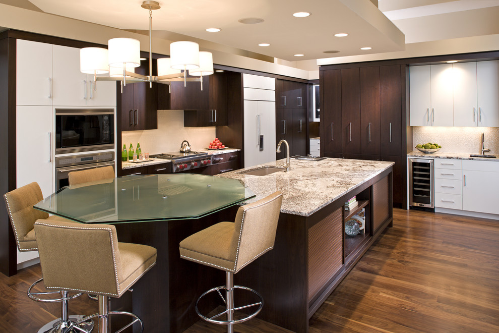 Trendy kitchen photo in Minneapolis with flat-panel cabinets and dark wood cabinets