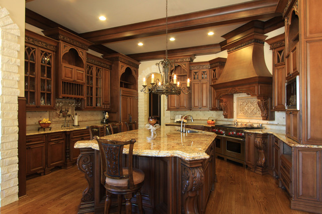 example of a huge classic u shaped medium tone wood floor eat in kitchen - High End Kitchen