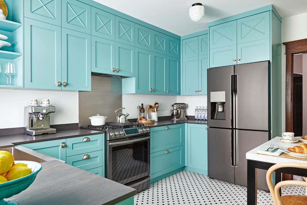 Inspiration for a tropical kitchen remodel in Toronto with a farmhouse sink, shaker cabinets, blue cabinets, metallic backsplash, metal backsplash, stainless steel appliances and no island