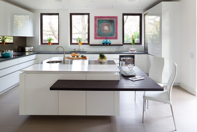 Contemporary l-shaped kitchen in London with flat-panel cabinets, white cabinets and an island.