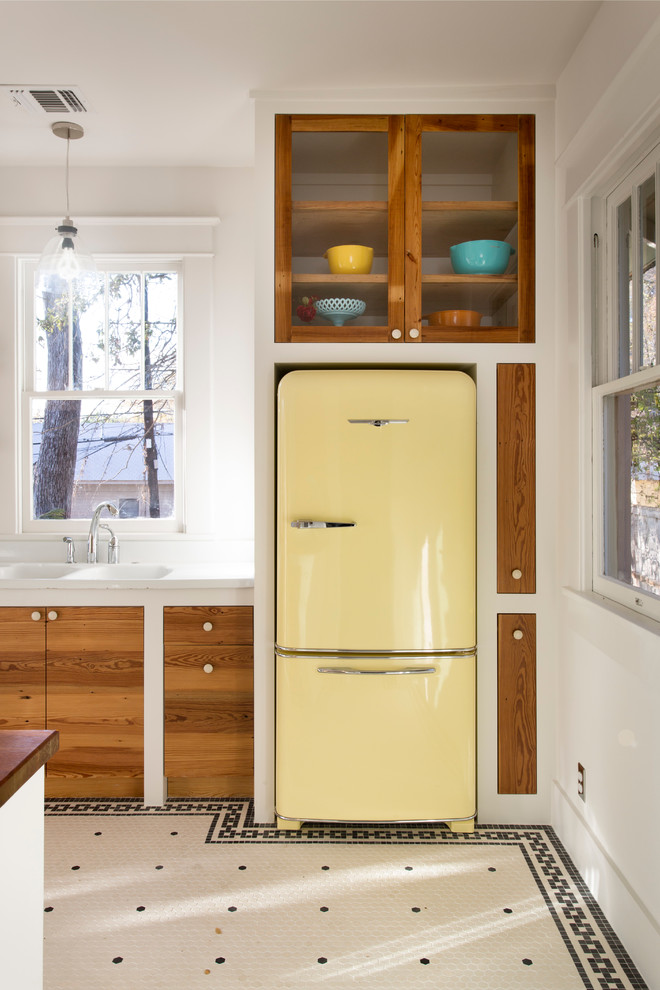 Eclectic kitchen photo in Austin with colored appliances