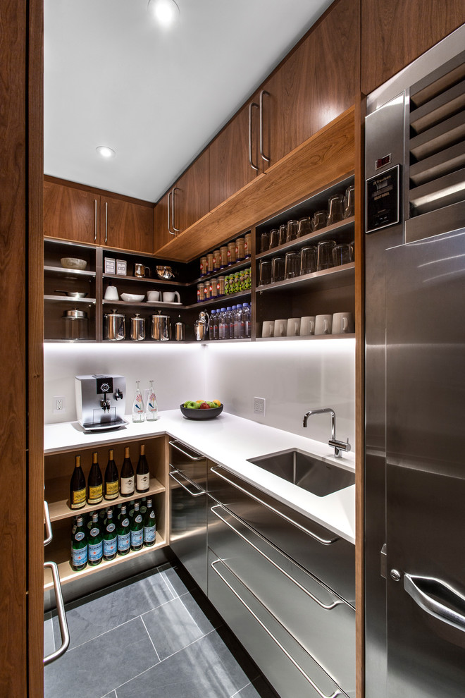 Example of a trendy u-shaped gray floor kitchen pantry design in Toronto with an undermount sink, flat-panel cabinets, stainless steel cabinets, stainless steel appliances and no island