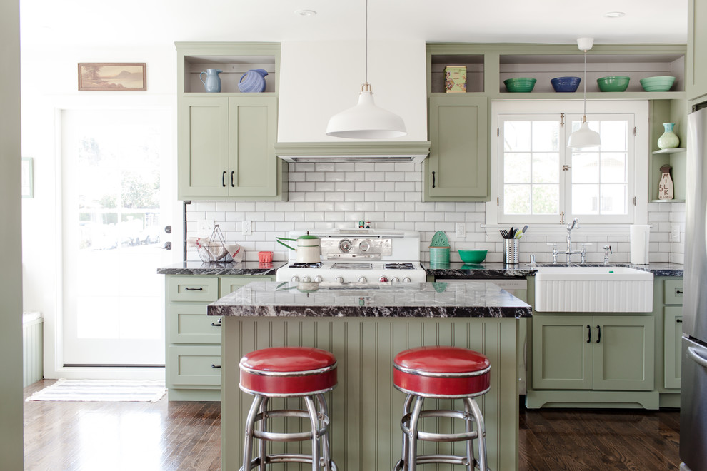 Kitchen - traditional kitchen idea in Los Angeles with green cabinets, white backsplash, subway tile backsplash, an island and a farmhouse sink