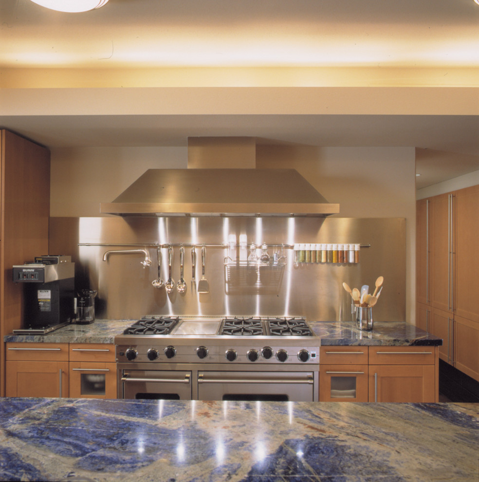 Kitchen - contemporary kitchen idea in Chicago with light wood cabinets, metallic backsplash, stainless steel appliances and blue countertops