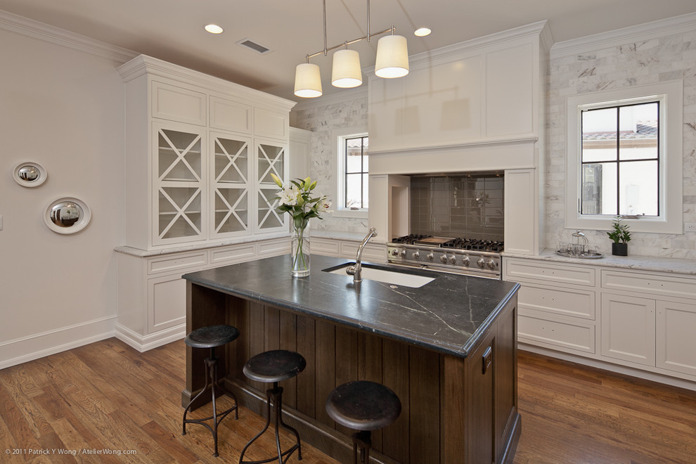 Inspiration for a transitional kitchen remodel in Austin with recessed-panel cabinets, soapstone countertops, white backsplash, stone tile backsplash, a single-bowl sink and white cabinets