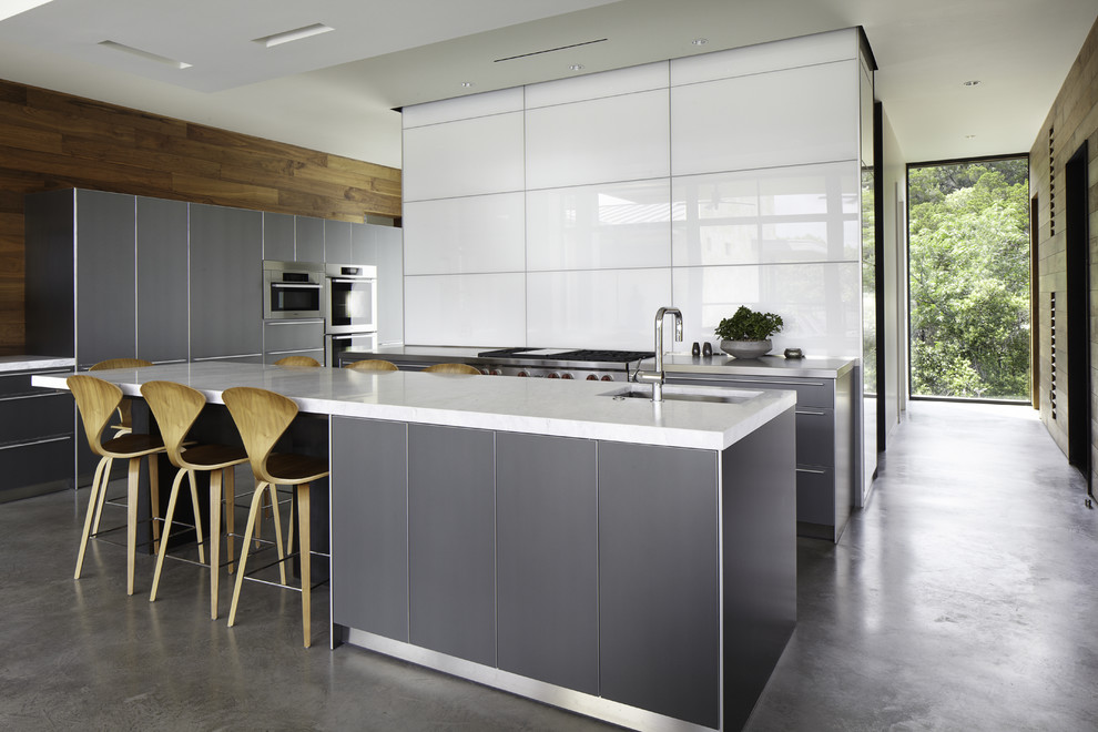 Kitchen - contemporary galley kitchen idea in Austin with flat-panel cabinets and gray cabinets
