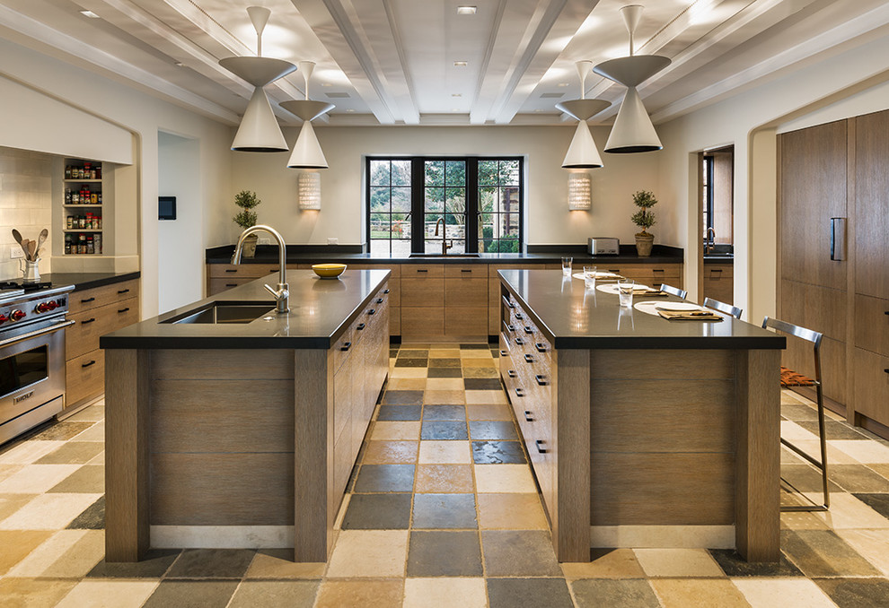 Example of a trendy kitchen design in Philadelphia with flat-panel cabinets, medium tone wood cabinets and stainless steel appliances