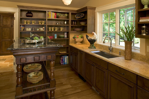 A butler's pantry offers extra storage and clean up space.