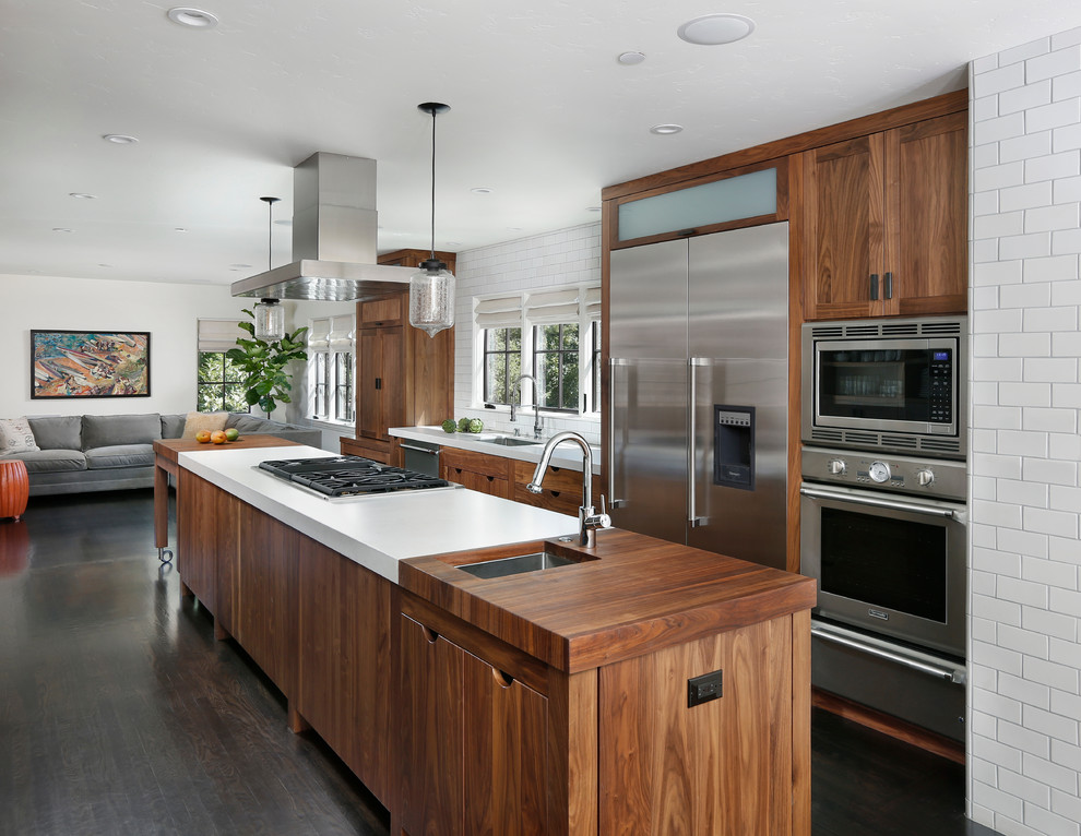 Inspiration for a contemporary galley kitchen remodel in San Francisco with stainless steel appliances, wood countertops and dark wood cabinets