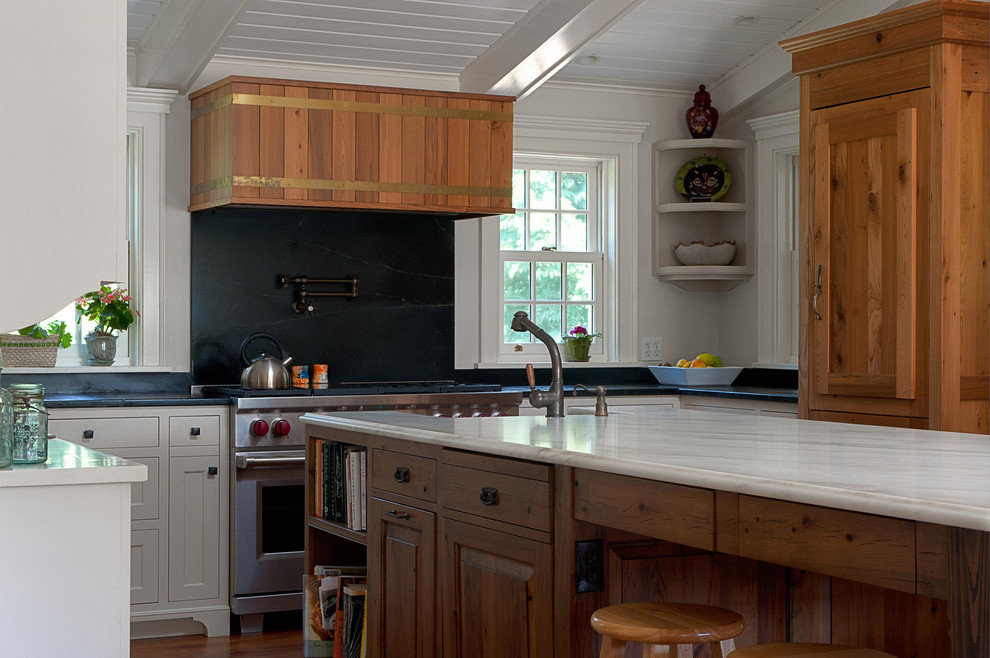 Example of a mountain style u-shaped kitchen design in New York