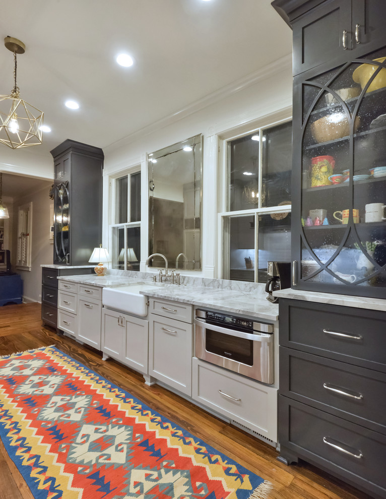 Inspiration for a timeless medium tone wood floor kitchen remodel in Charleston with a farmhouse sink, shaker cabinets, gray cabinets and stainless steel appliances