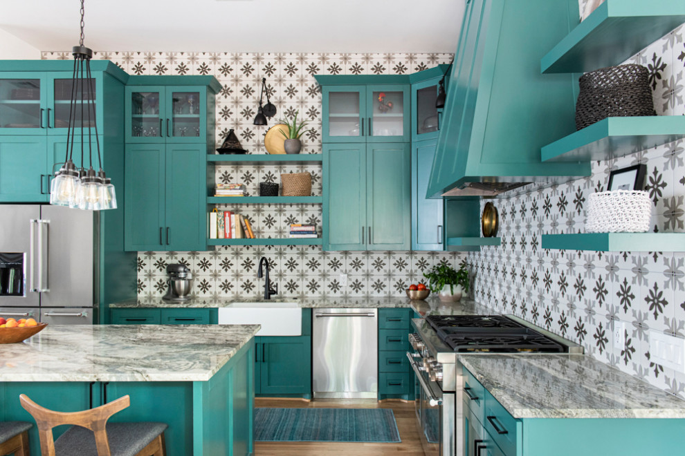 Kitchen - transitional kitchen idea in Houston with a farmhouse sink, shaker cabinets and an island