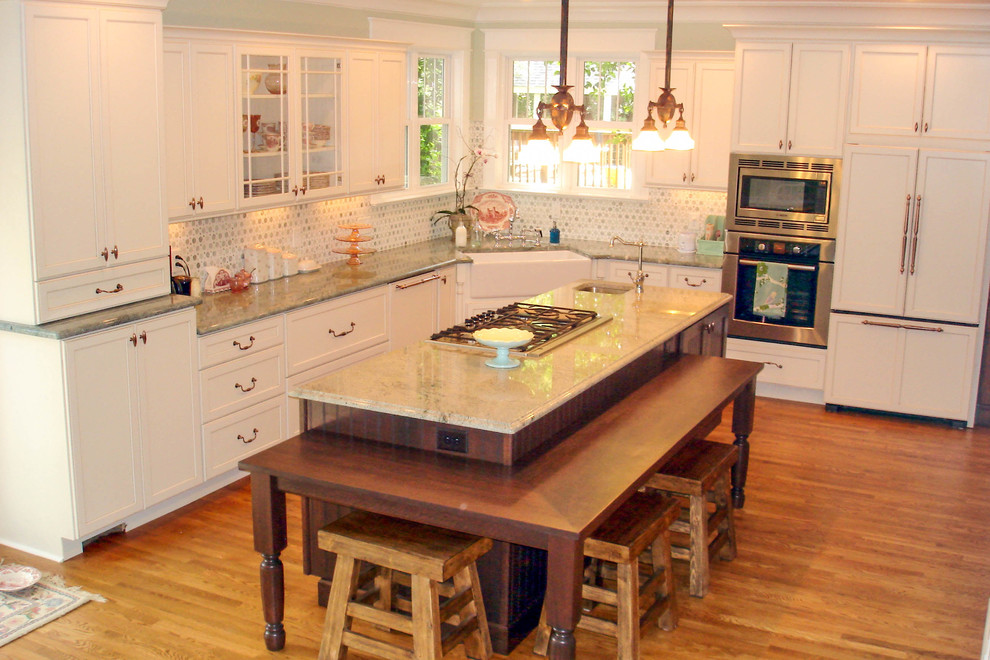 Inspiration for a timeless l-shaped eat-in kitchen remodel in Cincinnati with a farmhouse sink, recessed-panel cabinets, white cabinets, granite countertops and paneled appliances