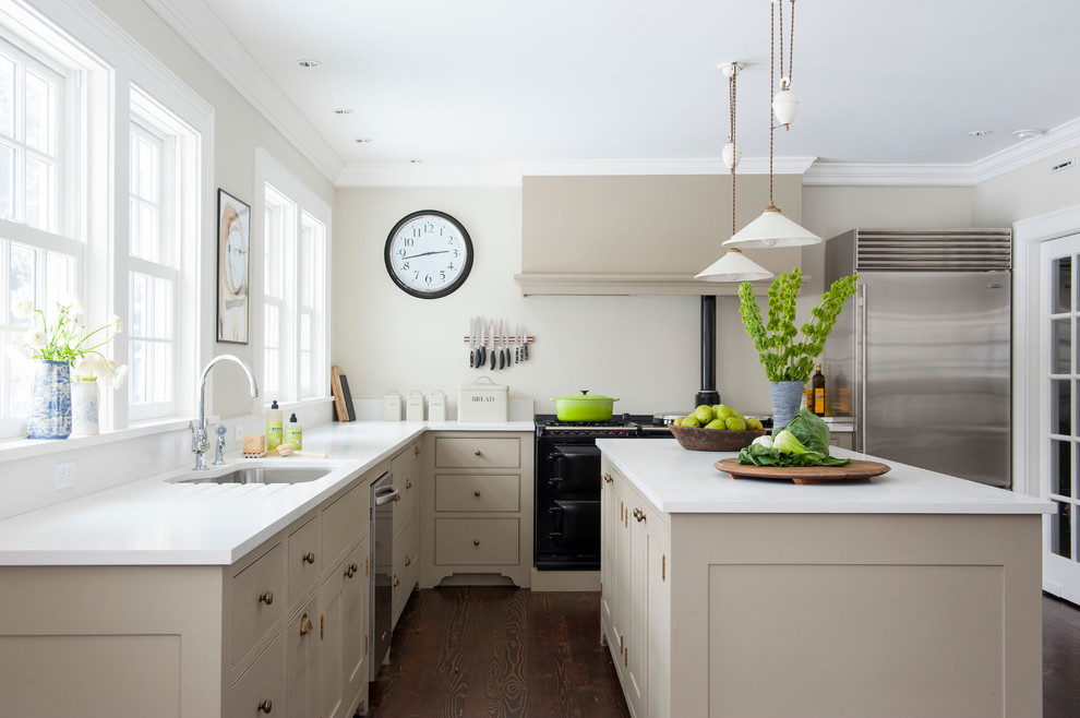 Example of a transitional l-shaped enclosed kitchen design in Bridgeport with shaker cabinets, beige cabinets and stainless steel appliances