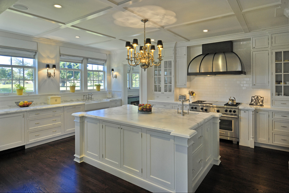 Example of a classic kitchen design in Miami with shaker cabinets, stainless steel appliances, subway tile backsplash, a farmhouse sink, white cabinets, white backsplash and marble countertops