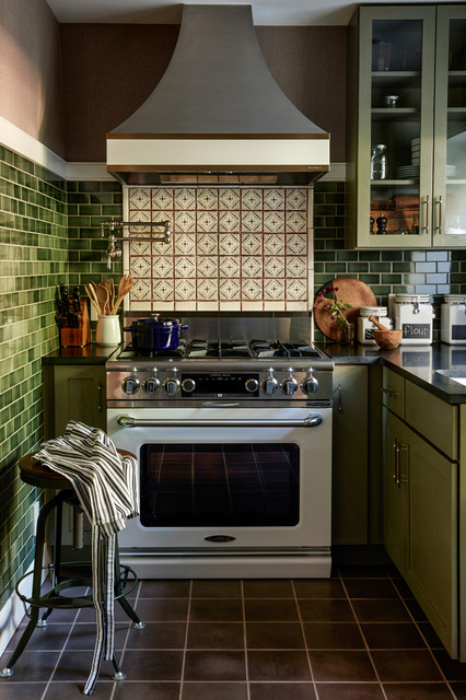 Elegant l-shaped brown floor kitchen photo in Philadelphia with glass-front cabinets, green cabinets, multicolored backsplash, white appliances and a peninsula