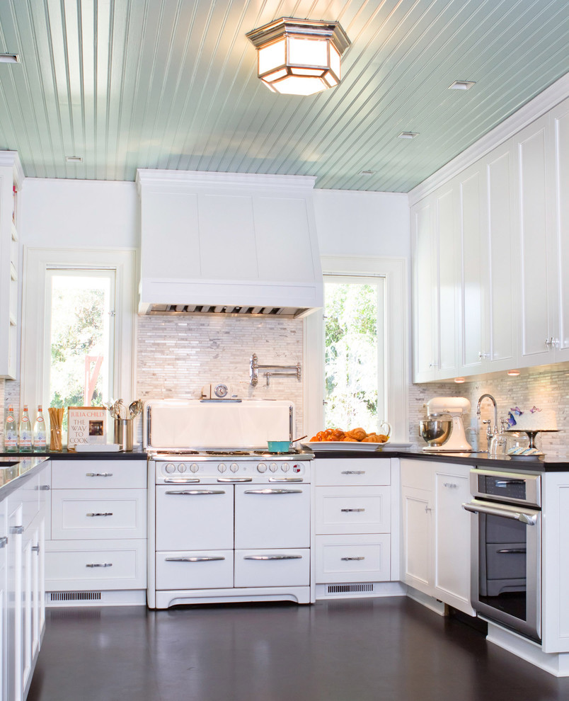 Inspiration for a timeless u-shaped kitchen remodel in Los Angeles with recessed-panel cabinets, white appliances and white cabinets