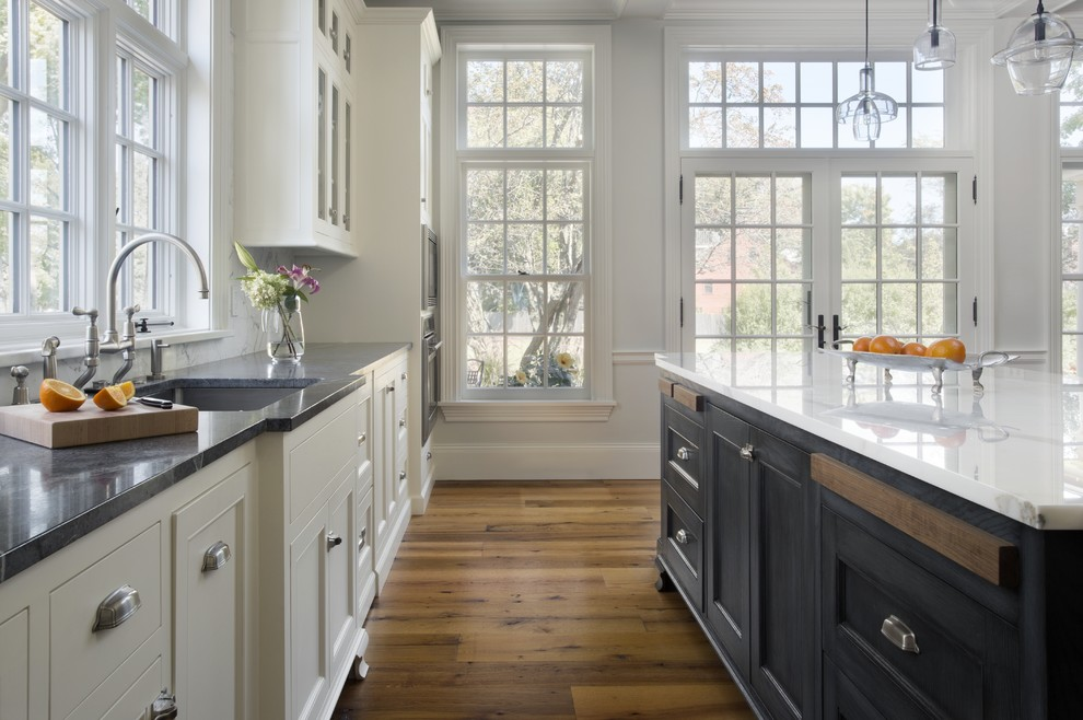 Example of a classic kitchen design in Boston with soapstone countertops