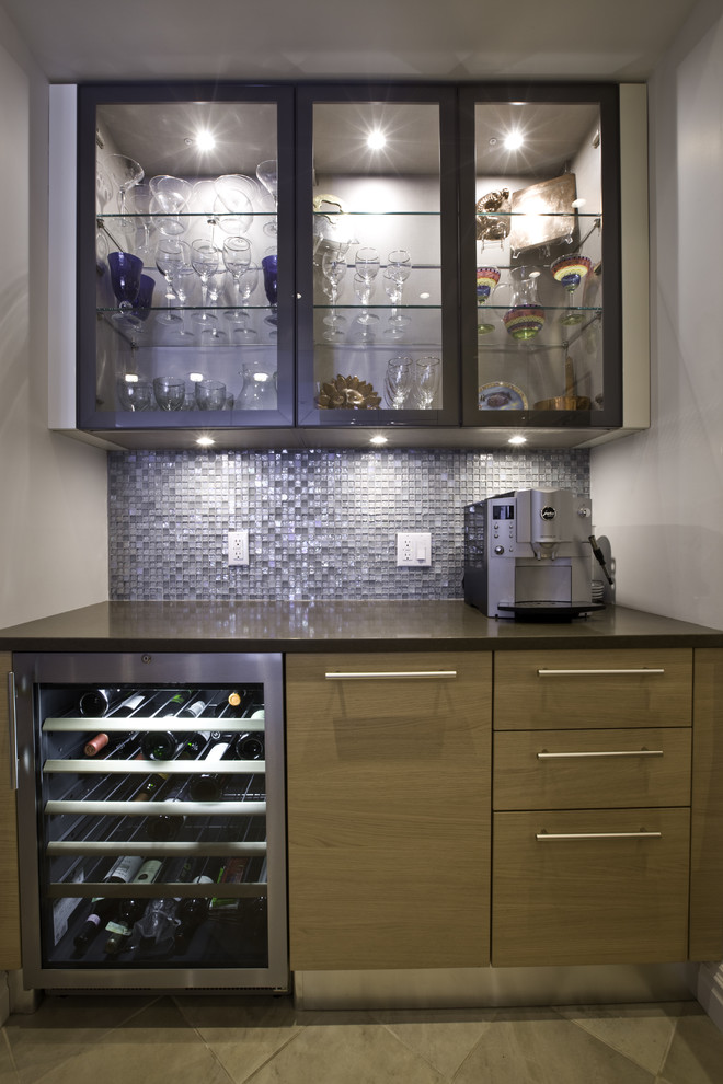 Example of a trendy kitchen design in New York with glass-front cabinets, medium tone wood cabinets and blue backsplash