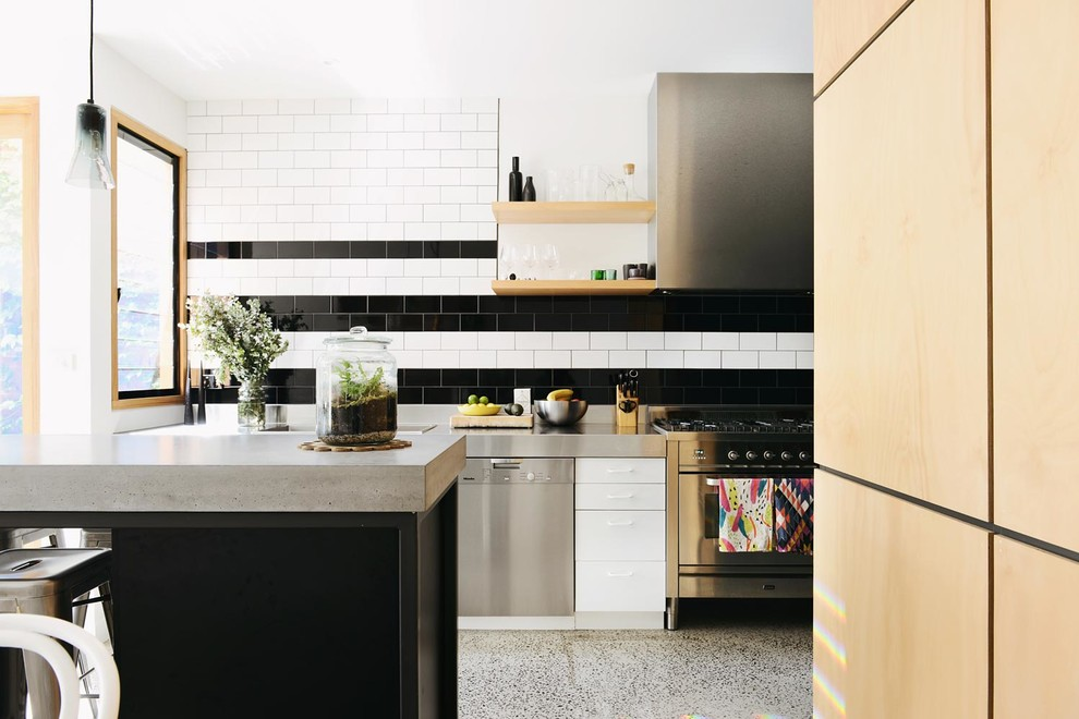 Example of a trendy kitchen design in Melbourne with concrete countertops, flat-panel cabinets, white cabinets, multicolored backsplash, subway tile backsplash and stainless steel appliances