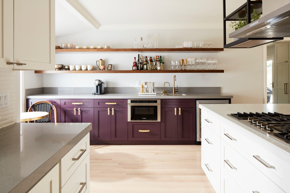 Inspiration for a contemporary light wood floor and beige floor kitchen remodel in San Francisco with shaker cabinets, purple cabinets and stainless steel appliances