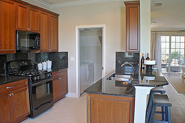 Homes by Deltona, Isles of the World, World Golf Village traditional-kitchen