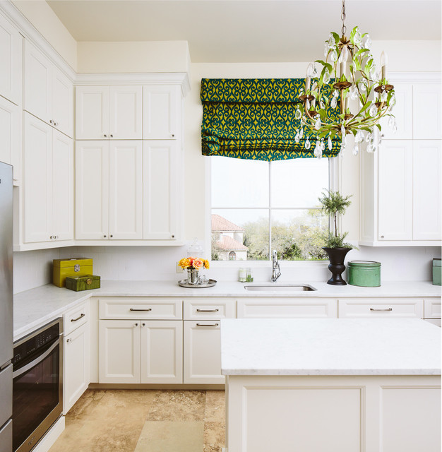 Inspiration for a classic kitchen in Austin with a submerged sink, recessed-panel cabinets, white cabinets, white splashback, metro tiled splashback, stainless steel appliances and an island.