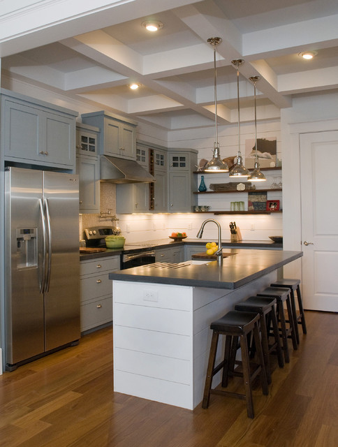 Inspiration for a timeless l-shaped kitchen remodel in Raleigh with stainless steel appliances, a farmhouse sink, gray cabinets, concrete countertops and shaker cabinets