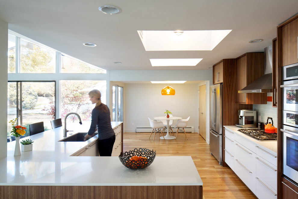 Example of a 1960s kitchen design in Denver with stainless steel appliances