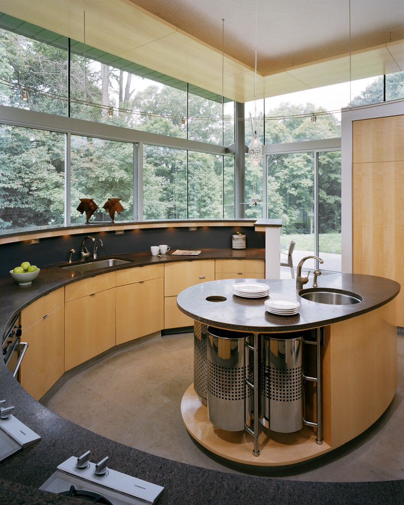 Eat-in kitchen - large contemporary u-shaped marble floor, gray floor and wood ceiling eat-in kitchen idea in Philadelphia with an undermount sink, flat-panel cabinets, light wood cabinets, black backsplash, an island, solid surface countertops, stone tile backsplash and black appliances