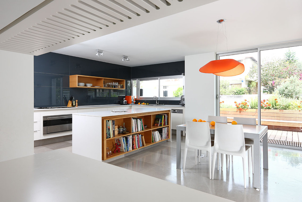 Eat-in kitchen - small modern l-shaped limestone floor eat-in kitchen idea in Tel Aviv with open cabinets, white cabinets, blue backsplash, glass sheet backsplash, stainless steel appliances, a drop-in sink, quartz countertops and an island