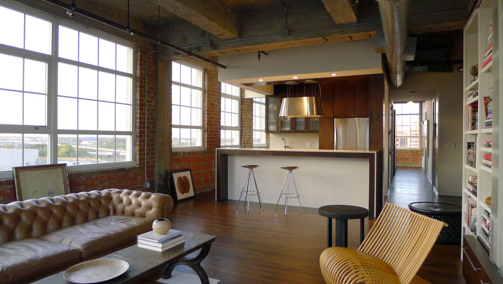 Urban galley open concept kitchen photo in Houston with flat-panel cabinets and medium tone wood cabinets