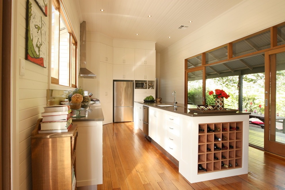 Inspiration for a transitional kitchen remodel in Sydney with an undermount sink, shaker cabinets, white cabinets and stainless steel appliances