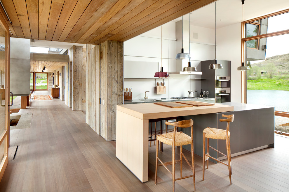Minimalist kitchen photo in Los Angeles with wood countertops
